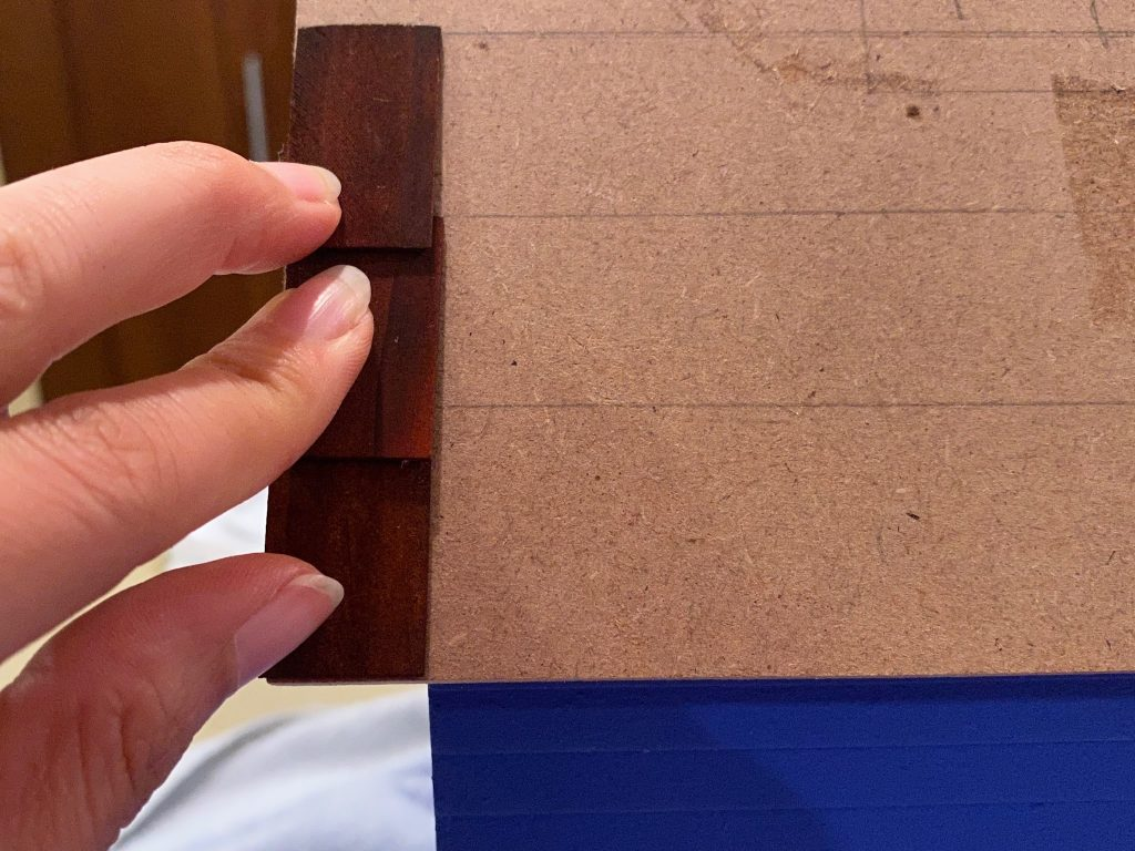 An overlapping row of shingles during the dry fit