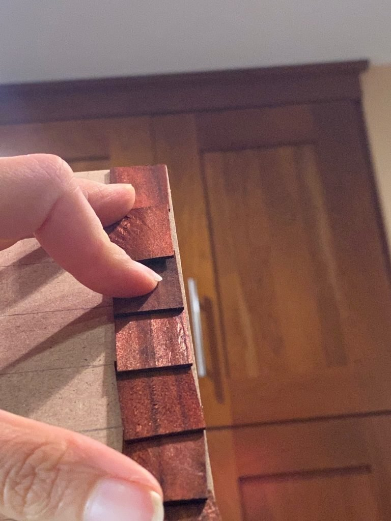 Dry fitting the dollhouse roof shingles bottom to top