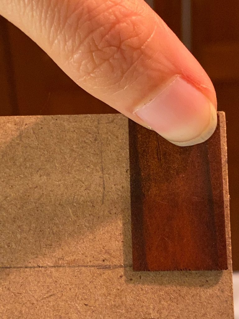 The top shingle for the dollhouse roof