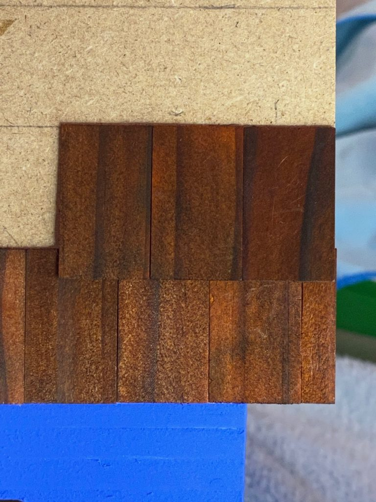 The first 3 shingles of the second row of dollhouse roof shingles