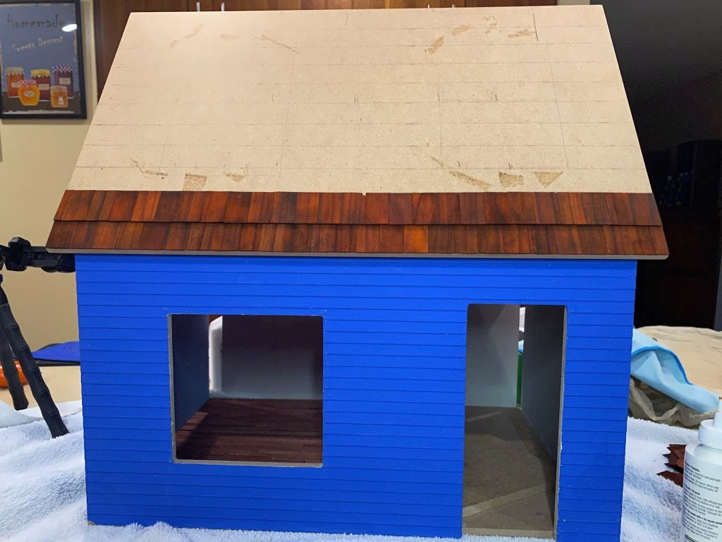 The first two rows of dollhouse roof shingles